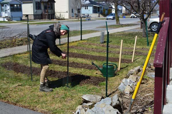 Ronja Works on fence